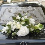 plage arriere fleurs voiture mariage